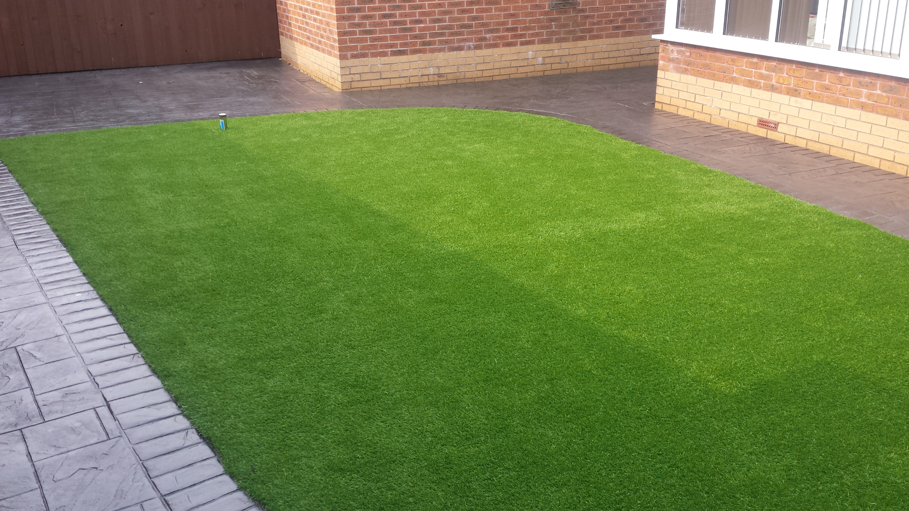 Artificial Grass Pattern Imprinted Concrete Driveways